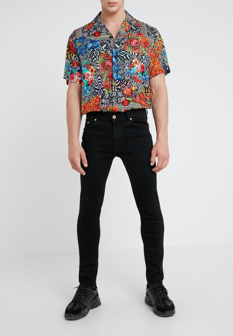 Versace Jeans Couture - PANTALONI UOMO - Jeans Skinny Fit - nero