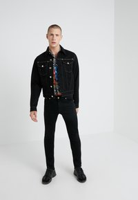 Versace Jeans Couture - PANTALONI UOMO - Jeans Skinny Fit - nero - 1