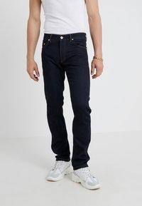 Versace Jeans Couture - PANTALONI UOMO - Vaqueros slim fit - indigo - 0