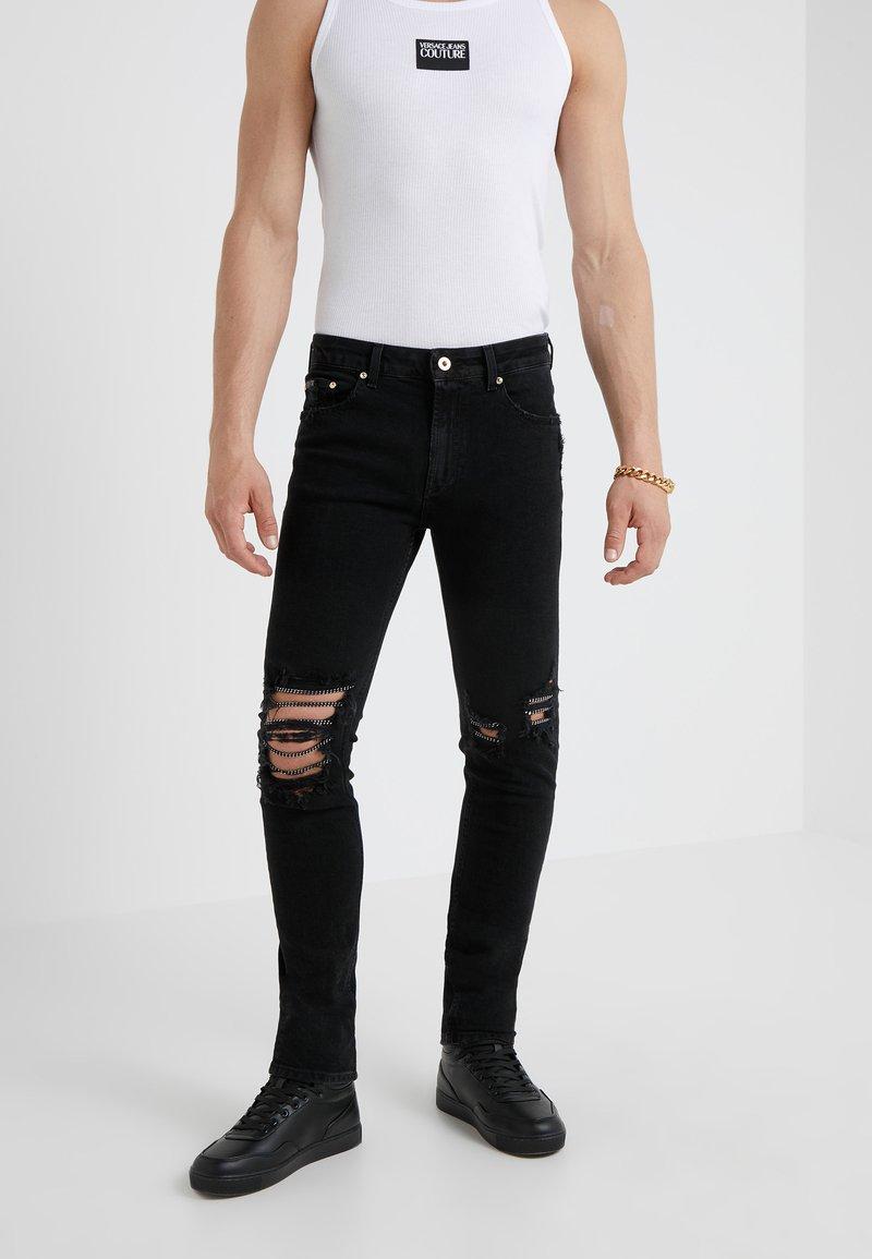 Versace Jeans Couture - PANTALONI UOMO - Vaqueros slim fit - nero