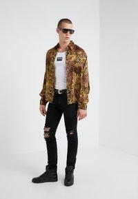 Versace Jeans Couture - PANTALONI UOMO - Jean slim - nero - 1
