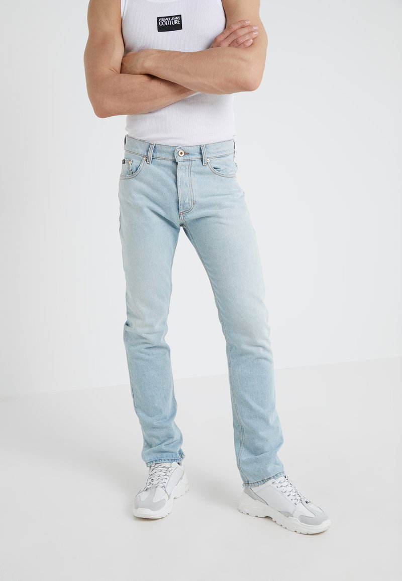 Versace Jeans Couture - PANTALONE - Jeans Slim Fit - indigo
