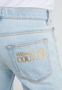 Versace Jeans Couture - PANTALONE - Jeans Slim Fit - indigo - 4