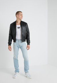 Versace Jeans Couture - PANTALONE - Jeans Slim Fit - indigo - 1