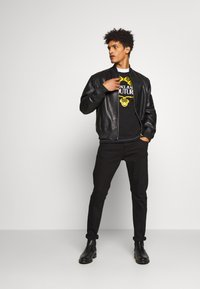 Versace Jeans Couture - Jeansy Slim Fit - black - 1