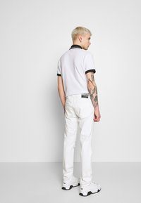 Versace Jeans Couture - MILANO DESTROYED - Slim fit jeans - white - 2