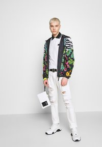 Versace Jeans Couture - MILANO DESTROYED - Slim fit jeans - white - 1