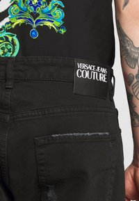 Versace Jeans Couture - MILANO DESTROYED - Slim fit jeans - black - 5
