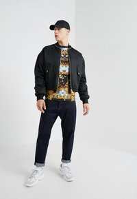 Versace Jeans Couture - MAGLIETTE UOMO - T-shirt med print - nero - 1