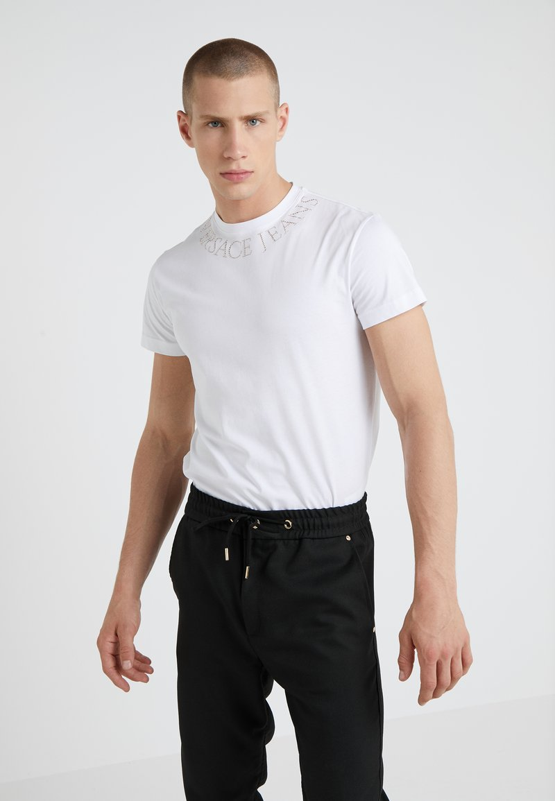 Versace Jeans Couture - MAGLIETTE  - T-shirts med print - bianco ottico