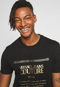 Versace Jeans Couture - LOGO SLIM - Print T-shirt - black - 3