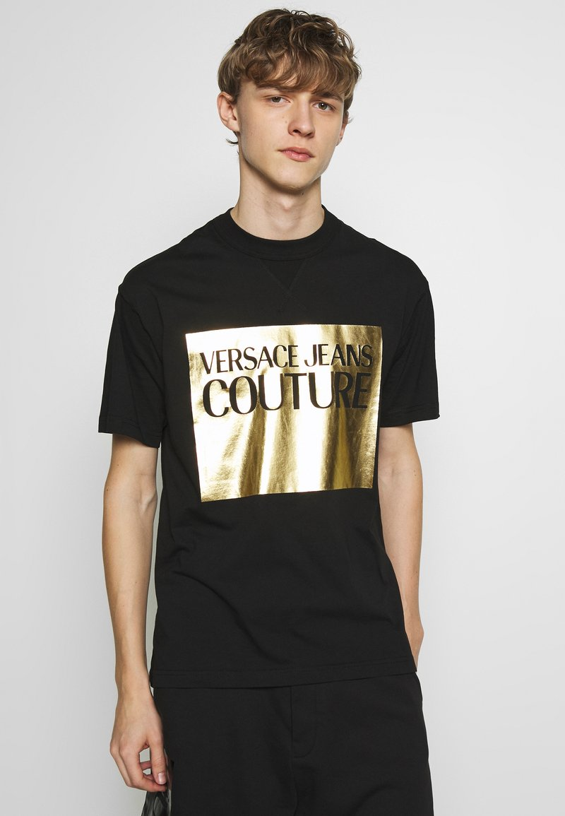 Versace Jeans Couture - FOIL LOGO WITHOUT THE 'BE BAROQUE' PATCH REGULAR FIT - T-shirt print - black