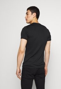 Versace Jeans Couture - SKINNY - T-shirt print - black - 2
