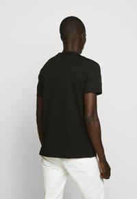 Versace Jeans Couture - TONAL ALLOVER LOGO - Print T-shirt - black - 2