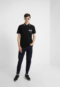 Versace Jeans Couture - Poloshirt - nero - 1