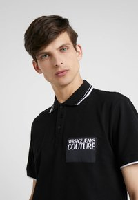 Versace Jeans Couture - Poloshirt - nero - 4
