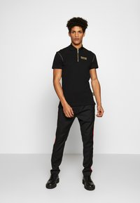 Versace Jeans Couture - ZIP POLO - Koszulka polo - black - 1