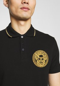 Versace Jeans Couture - EMBROIDERY - Polo shirt - black