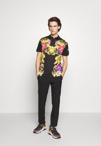 Versace Jeans Couture - FLORAL PRINT - Polo - black - 1