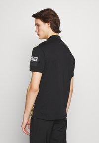 Versace Jeans Couture - FLORAL PRINT - Polo - black - 2