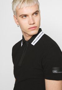 Versace Jeans Couture - ZIP - Koszulka polo - black - 4