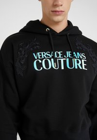 Versace Jeans Couture - EMBROIDERED HOODIE - Hoodie - black - 4