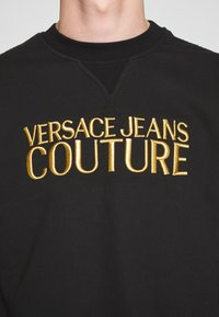 Versace Jeans Couture - CREW BASIC LOGO EMBROIDERED - Sweater - black - 5