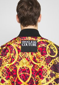 Versace Jeans Couture - REVERSIBLE BOMBER - Bomber Jacket - red - 7
