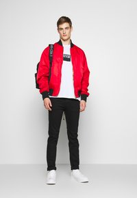 Versace Jeans Couture - REVERSIBLE BOMBER - Bomber Jacket - red - 1