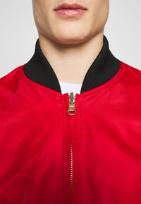 Versace Jeans Couture - REVERSIBLE BOMBER - Bomber Jacket - red - 5