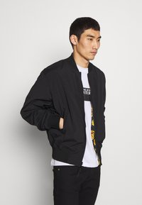 Versace Jeans Couture - ALLOVER GIOIELLI REVERSIBLE - Summer jacket - black - 3