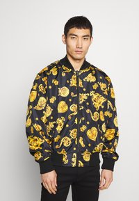 Versace Jeans Couture - ALLOVER GIOIELLI REVERSIBLE - Summer jacket - black - 0
