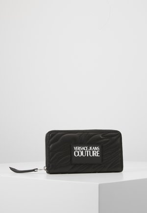 QUILTED ZIP AROUND PURSE - Wallet - nero
