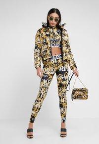 Versace Jeans Couture - CROSSBODY - Taška spříčným popruhem - black - 1