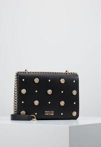 Versace Jeans Couture - FIORE - Taška spříčným popruhem - black - 0