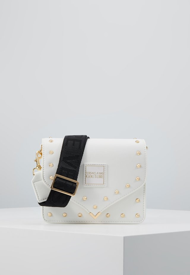 STUDDED FLAP OVER - Across body bag - white