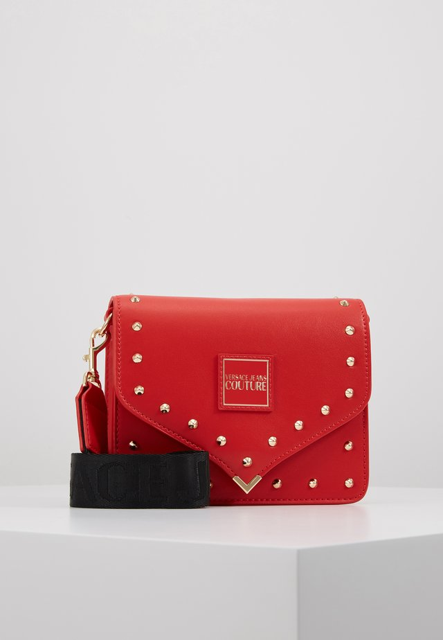STUDDED FLAP OVER - Across body bag - red