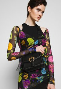 Versace Jeans Couture - BAROQUE BUCKLE FLAP OVER - Across body bag - black - 1