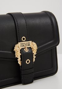 Versace Jeans Couture - BAROQUE BUCKLE FLAP OVER - Across body bag - black - 4