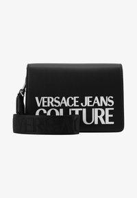 Versace Jeans Couture - MACRO LOGO FLAPOVER - Across body bag - black - 1