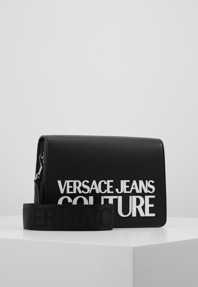 Versace Jeans Couture - MACRO LOGO FLAPOVER - Across body bag - black