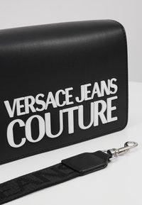 Versace Jeans Couture - MACRO LOGO FLAPOVER - Across body bag - black - 2