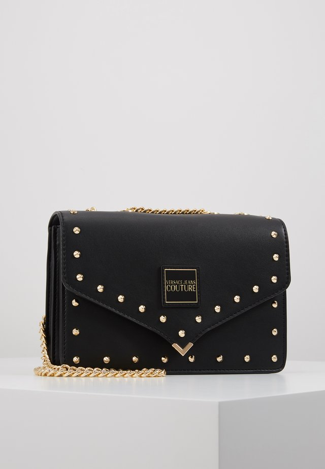 STUDDED SHOULDER BAG - Across body bag - black