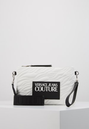 QUILTED POUCH WITH STRAP - Clutch - bianco