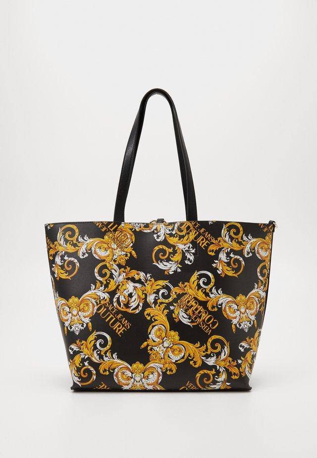 REVERSIBLE LOGO - Shoppingväska - black/yellow