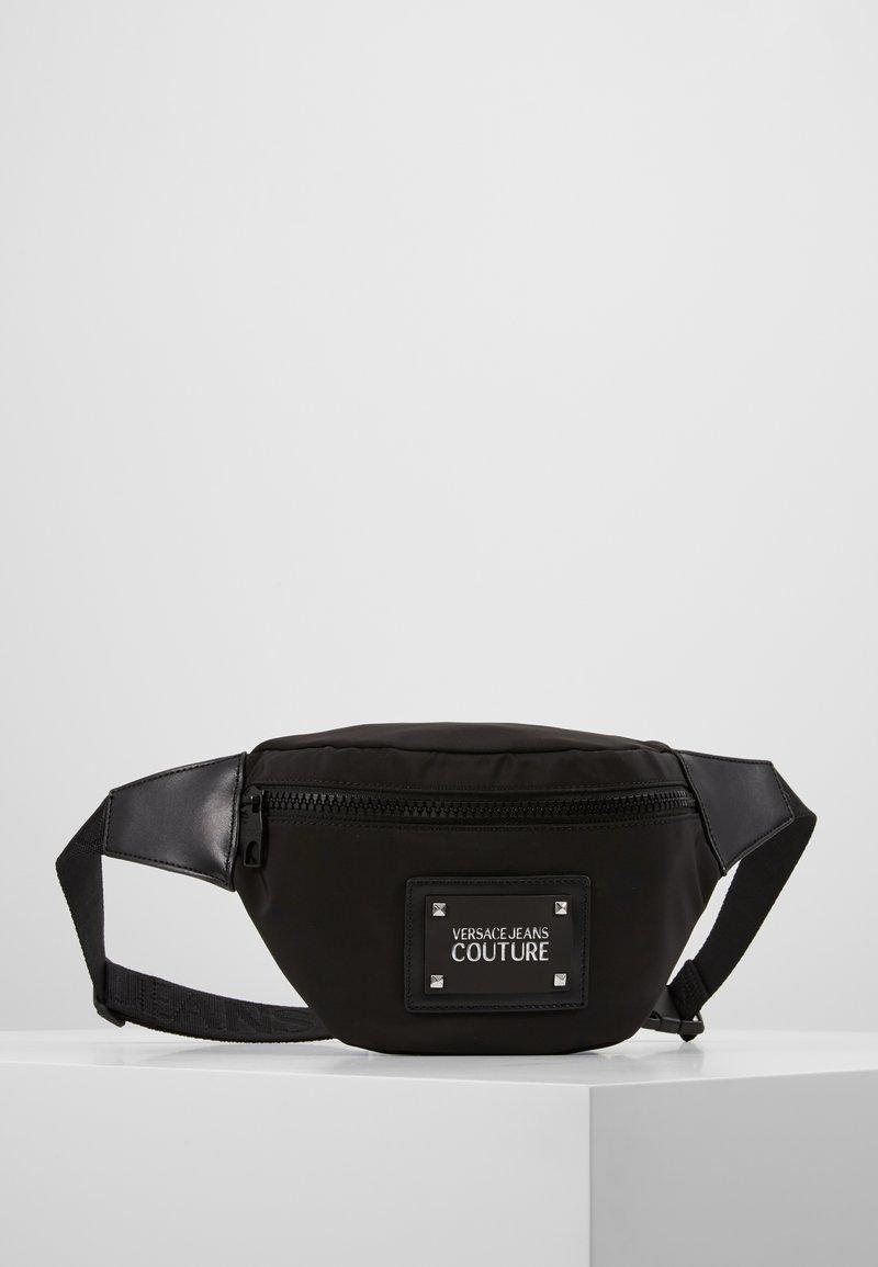 Versace Jeans Couture - LINEA PYTHON - Bältesväska - black