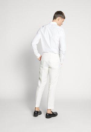 FINNMARK TROUSER - Spodnie materiałowe - white