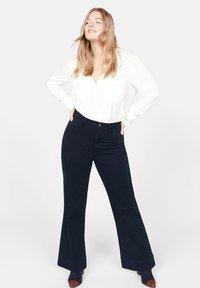 Violeta by Mango - CHRISTIN - Flared Jeans - dark navy blue - 1
