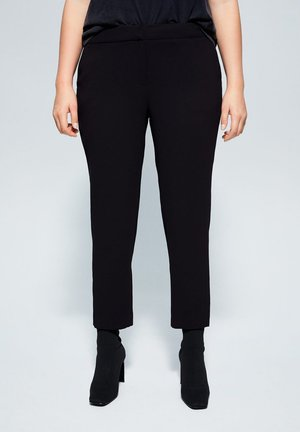 LEONOR - Trousers - black