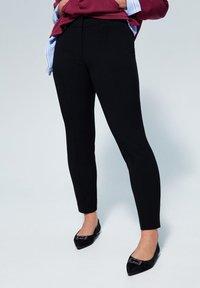 Violeta by Mango - SLIPY - Spodnie materiałowe - black - 0